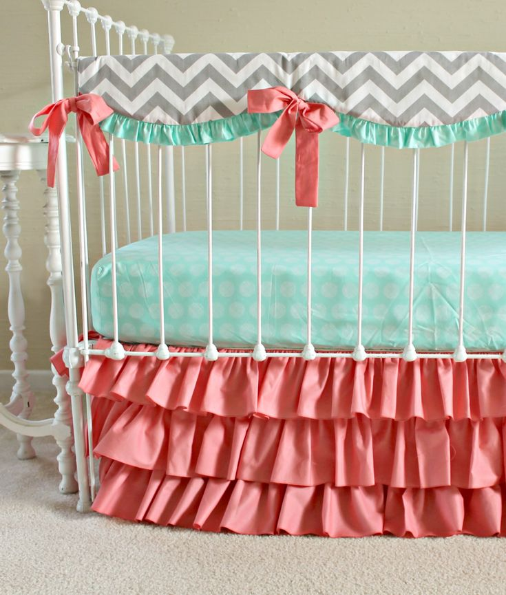 Wonderful Coral And Turquoise Bedding For Bedroom Decoration Ideas: White Skirted Crib With Coral And Turquoise Bedding Plus Ribbon For Nursery Furniture Ideas
