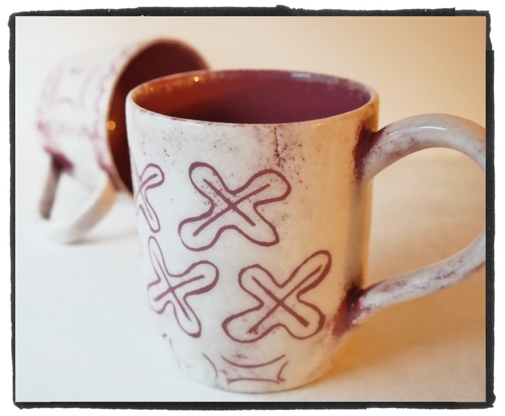 earthenware cup, red clay and white sgraffito decoration with traditional signs - segments