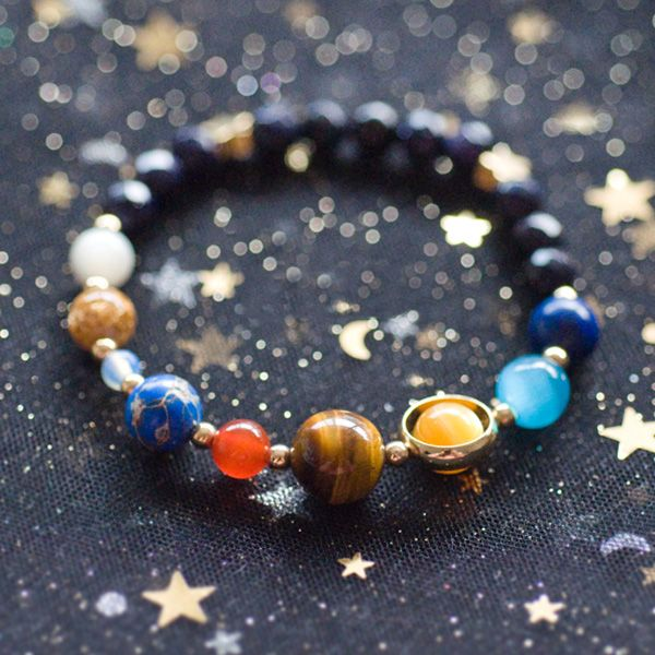 The planets align beautifully with our solar system bracelets. From single planet designs to the whole solar system, each handmade bracelet is a one-of-a-kind beauty. Wear one or stack them in spectacular solar style! <br> <ul><li> Handcrafted bracelets with unique gemstone planets and gold star charms </li> <li> Choose from 11 different styles </li> <li> Bracelets are 6.3 inches with 1.4 inch extenders </li> <li> A great ...
