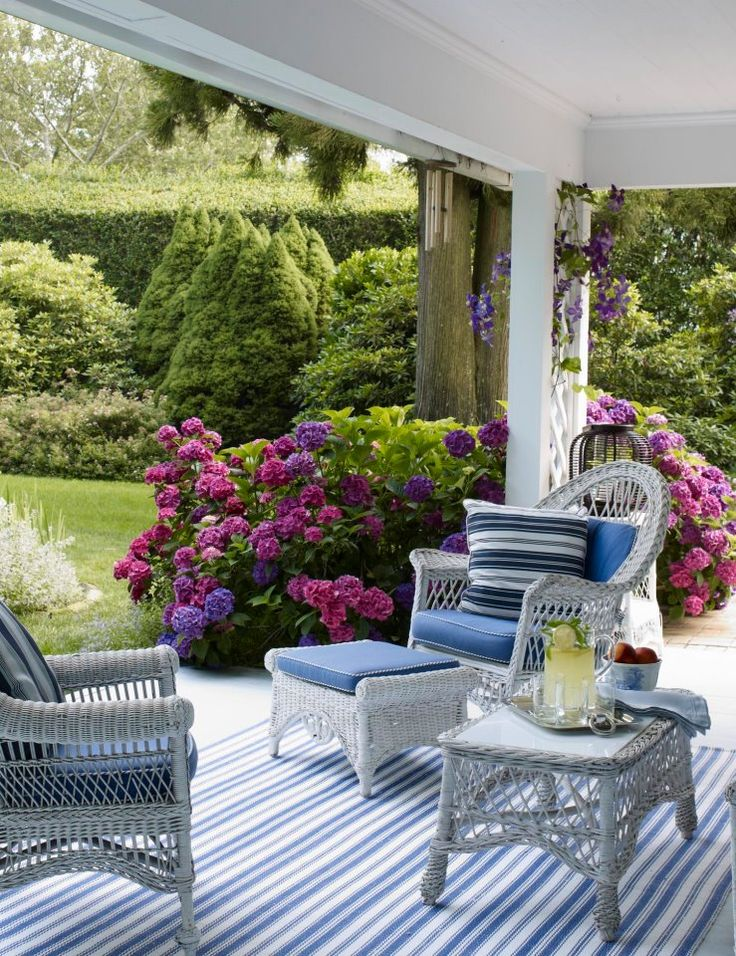white wicker, hydrangeas, and stripes....perfect combination Traditional Home