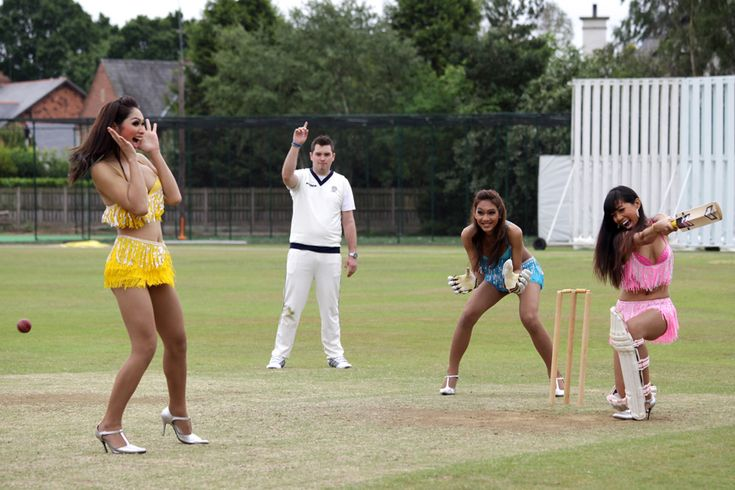 Thai ladyboys learning how to play cricket at Hale, Cheshire, in 2010.