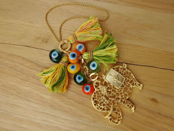 Gold Filigree Elephant Charm Evil Eye Beaded Tassel Home Decor - Door Knob Decor  -Evil Eye Beaded Wall Hanging by cocolocca on Etsy https://www.etsy.com/listing/210422631/gold-filigree-elephant-charm-evil-eye
