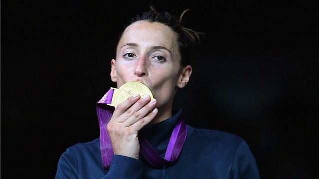 Elisa Di Francisca of Italy kisses her gold medal in the women's Foil Individual Fencing final against Arianna Errigo of Italy on Day 1 of the London 2012 Olympic Games at ExCeL on 28 July 2012.