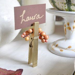 Gold name place setting or could hold dish labels on a buffet table