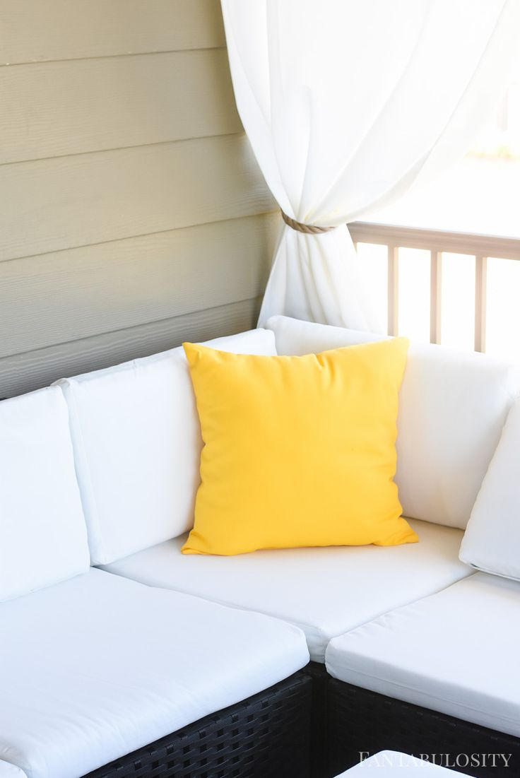 Yellow outdoor pillows for a white sectional sofa