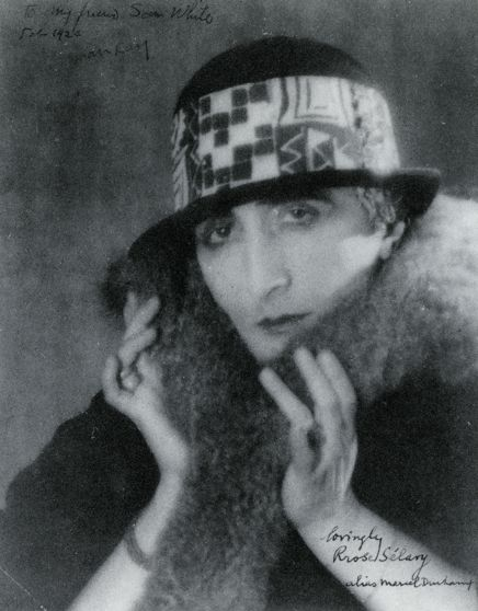 "Marcel Duchamp's female alter-ego Rrose Sélavy fully surfaced in  photographs by Man Ray, 1921 Her name sounds like Eros, c'est la vie, or ""Eros, that's life."""