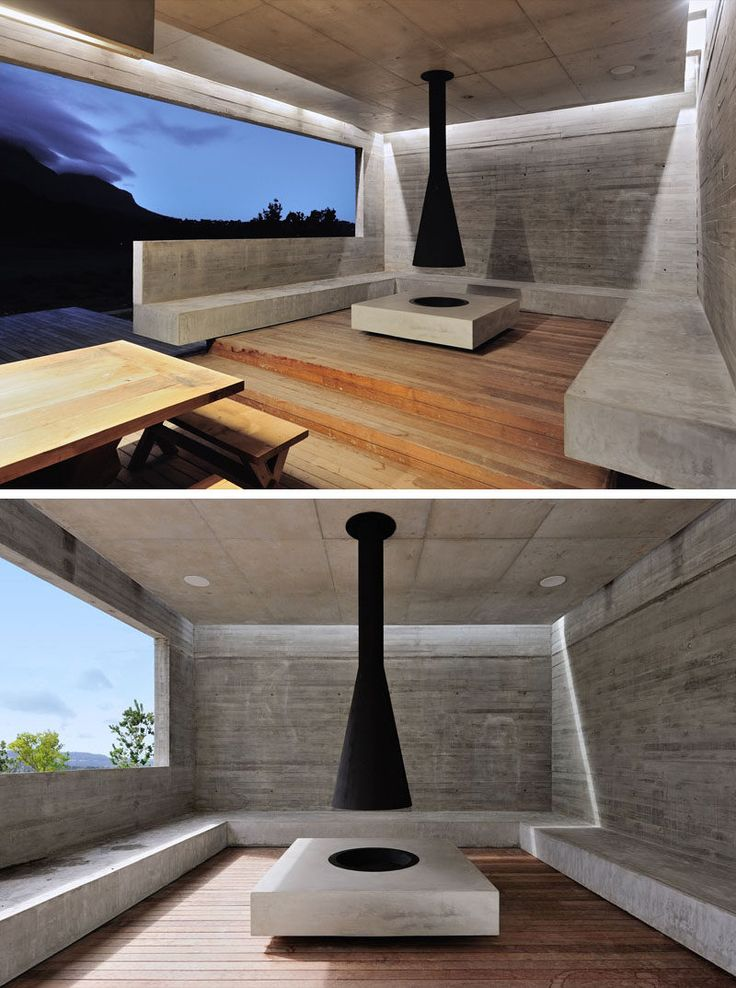 Located in this outdoor garden pavilion, is a raised seating area with concrete…