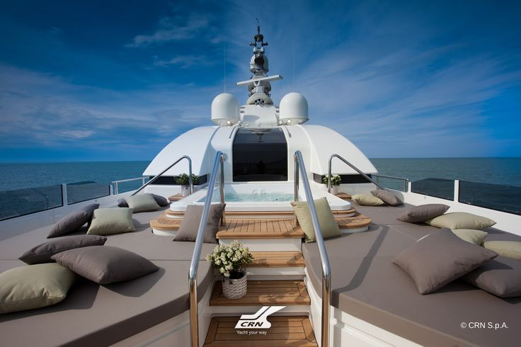 The sun deck of CRN M/Y J'Ade 60m has a solarium with sofas and sun beds. The cushions are taupe, reflecting the warm grey colour of the hull, together with other jade green cushions. This bow area can be turned into a touch-and-go heliport. The indoor area is dedicated to wellness, with a Turkish bath and a steam bath with green mosaics and a gym area equipped with fitness machines. At the bow, outside, there is a big rectangular spa pool with two large sunbeds.