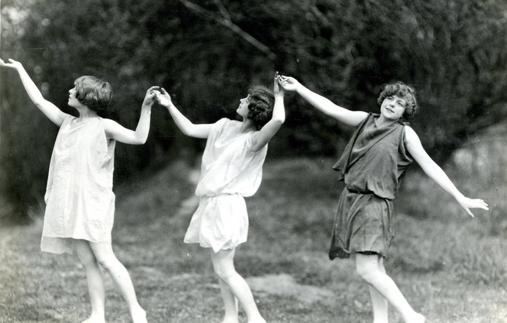 group portrait of three female dancers associated with the State College of Washington (now called Washington State University) holding hands as they perform, sometime between 1924-1930
