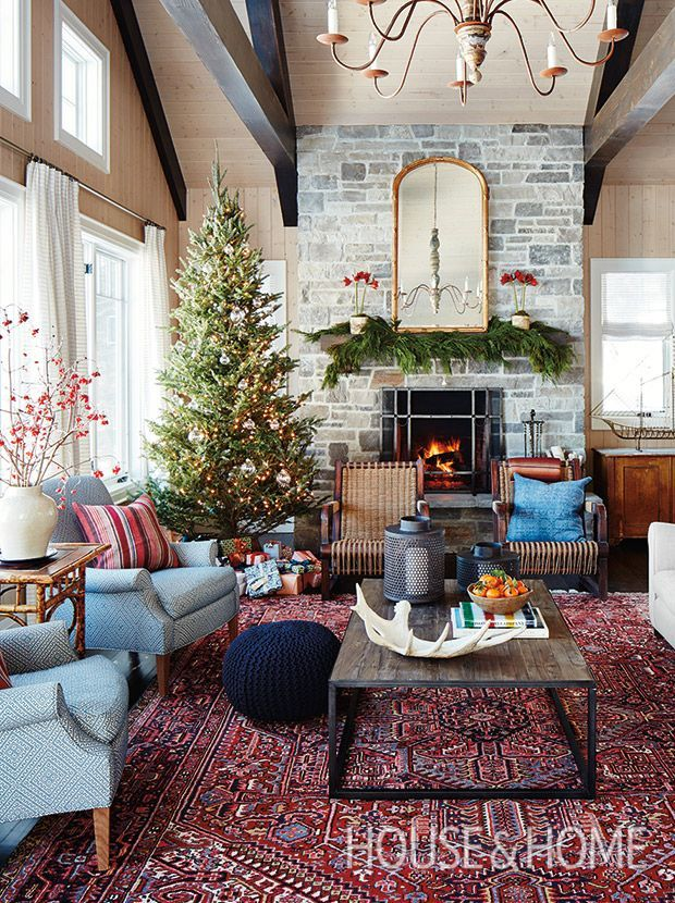 The first thing the Conlon family do every Christmastime when they arrive at their Muskoka, Ontario, cottage is put up the impressive tree in their living room. | Photographer: Stacey Brandford | Designer: Sarah Richardson Design