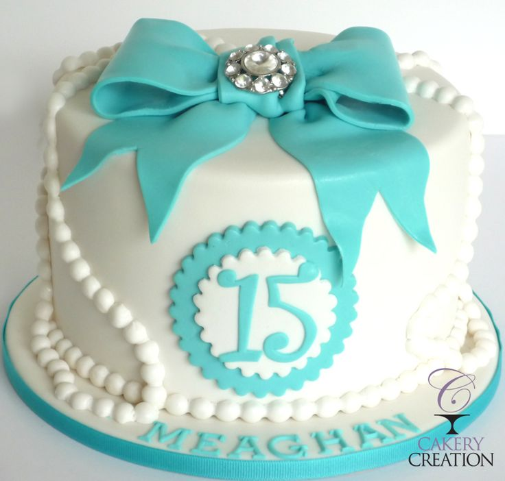 Tiffany blue bow with diamond brooch and pearls cake. By Cakery Creation in Daytona Beach