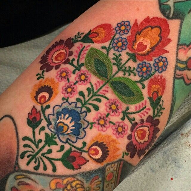 Gorgeous floral Swedish embroidery tattoo by Jasmine Wright