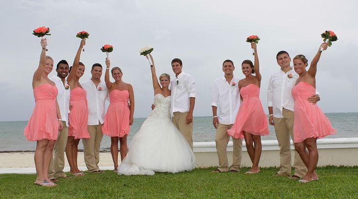 Bridal party at a destination wedding at Moon Palace Cancun. Pink bridesmaid dresses, white and khaki for the groomsmen. #beachwedding