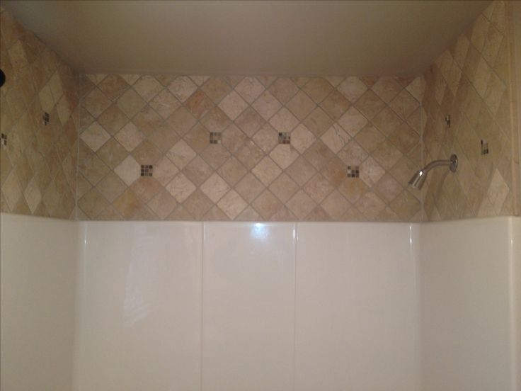 Fiberglass enclosure always leaves 2 foot of drywall above. For those who are not going to put a full tile shower and want to make it look a little better and make it non-maintenance this is your best option. avstile.com