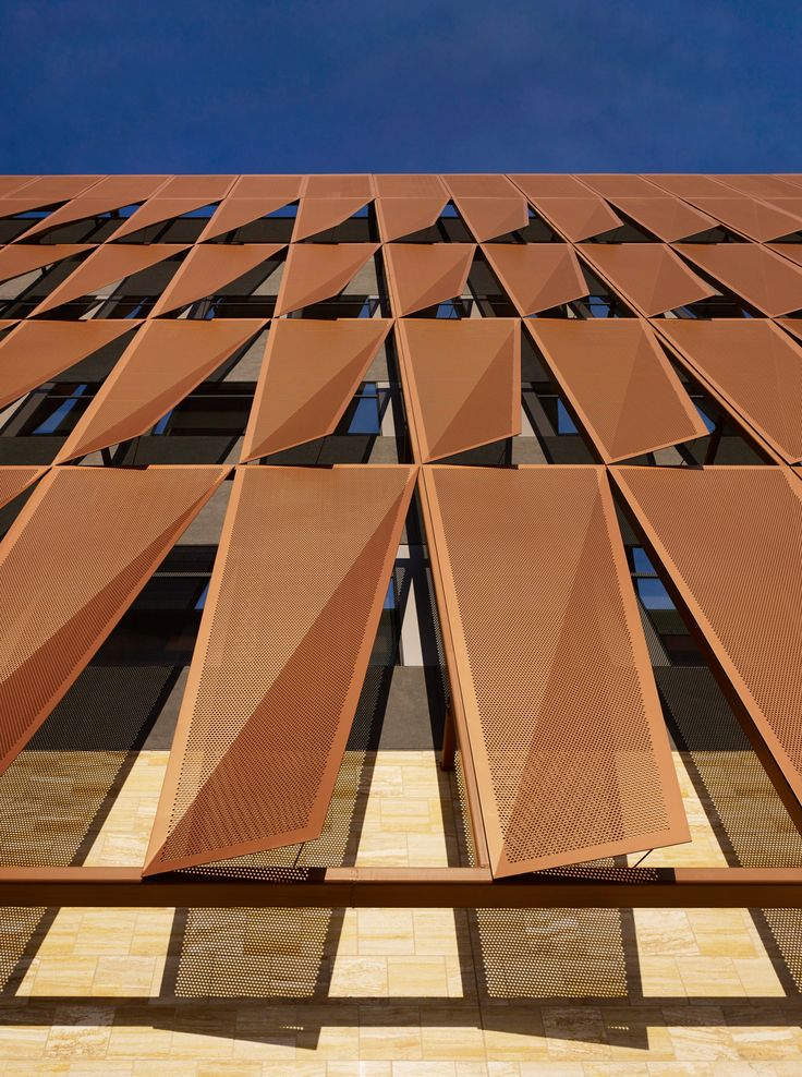 Univ. of Arizona cancer center by ZGF: perforated copper-colored panels