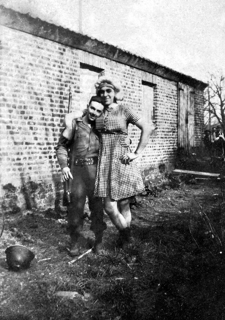 My grandpa in drag, WWII (1945). He and his buddies in the 1115th Combat Engineers put together a variety show to keep morale up. His wig was made of rope off a combat truck and his boobs were tissue boxes.
