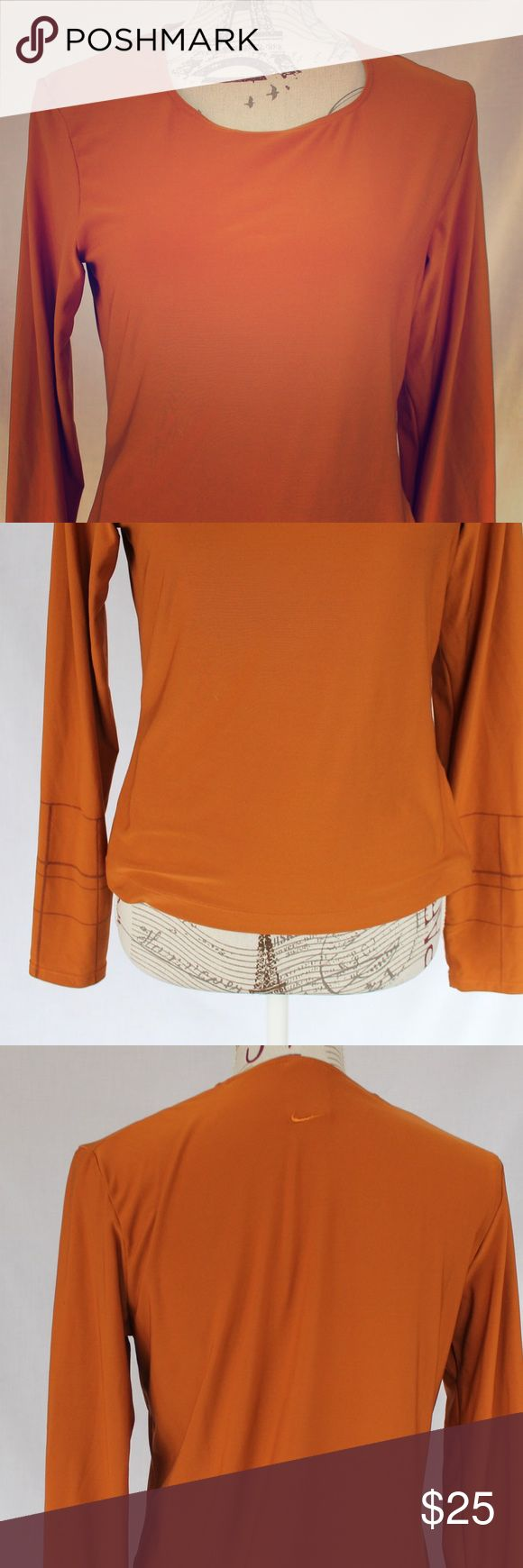 Nike workout gear pumpkin orange long sleeve shirt Nike workout gear pumpkin orange long sleeve shirt.  Cute design on cuffs!  Great as stand alone or thermal layer. Nike Tops Tees - Long Sleeve