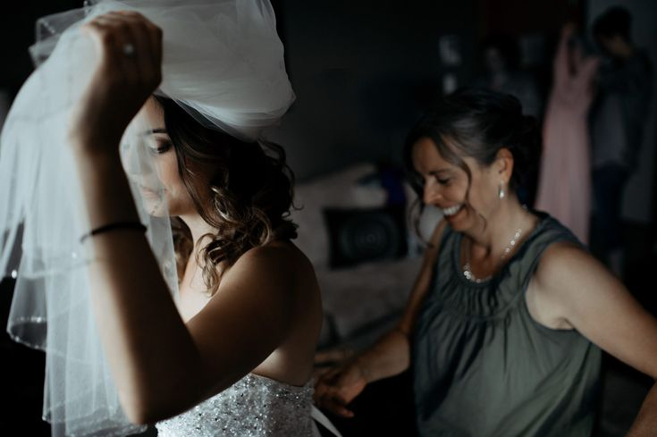Bride and her mom in the most precious wedding dress moment. By Ebony Logins - www.redcedarphoto.com