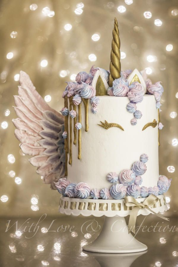 Unicorn Drip Cake with Meringue Wings - Cake by Veronica Arthur of With Love & Confection. My version of the ever so popular Unicorn cake with meringue kisses and MERINGUE WINGS! White chocolate drip painted in gold luster. Cake is 4 layers of unicorn swirl and iced in buttercream. BTW- I made this cake just for fun but it sold the next day after I posted it on facebook ;)