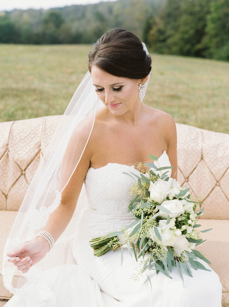 Elegant wedding hairstyle, lace-trimmed bridal veil, up-do bridal hair, Southern bride, pin this look to your own inspiration board // JoPhoto