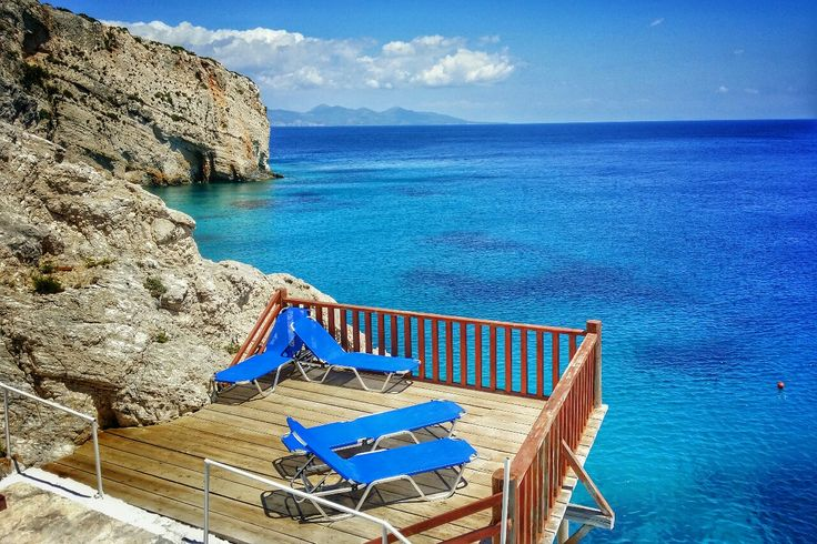Sun Loungers On The Cliff Side At Cape Skinari near the Blue Caves on Zakynthos island Greece Photography by Alistair Ford