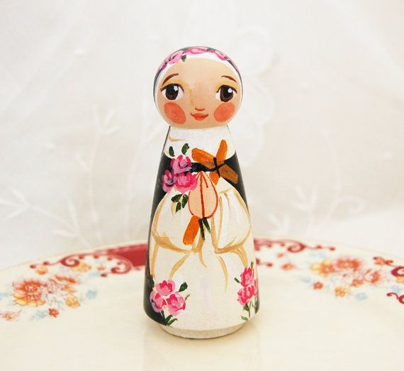 Saint Rose of Lima wooden statue doll ***This St. Rose of Lima doll will be made after purchase.Please allow up to three weeks for shipment. This item will resemble the photos essentially but will be different being that it is hand painted. If you wish to have a photo sent before it