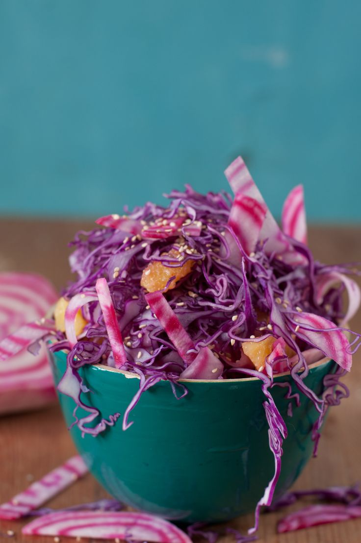 Red cabbage and candy-striped beets with orange and sesame seeds.