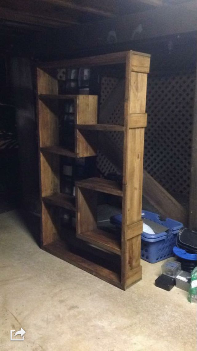 Rustic bookshelf from an old fence