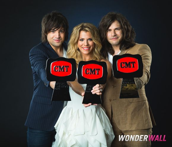 The Band Perry pose with their awards backstage at Wonderwall.com's portrait studio at the 2014 CMT Music Awards in Nashville, Tenn., on June 4, 2014.
