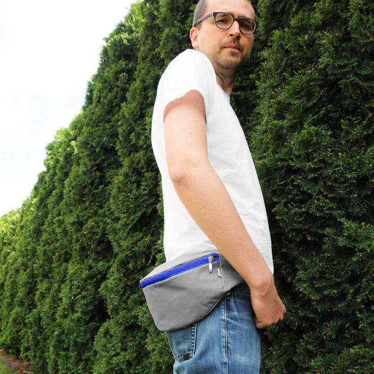 Unisexowa designerska nerka, saszetka z szarej tkaniny plecakowej.  Wymiary nerki: 28 cm x 14 cm. Regulowany pasek z taśmy nośnej - obwód 90 - 120 cm.  Nerka zapinana na zamek - kolor do wyboru: zielony, czarny, niebieski, żółty lub pomarańczowy. #nerka #beltbag #hipbag