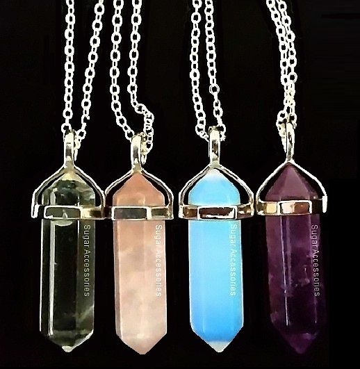 Gorgeous crystal point necklaces - Choose from 4 beautiful crystals (opalite, rose quartz, amethyst, clear quartz) on your choice of a black leather or silver chain.
