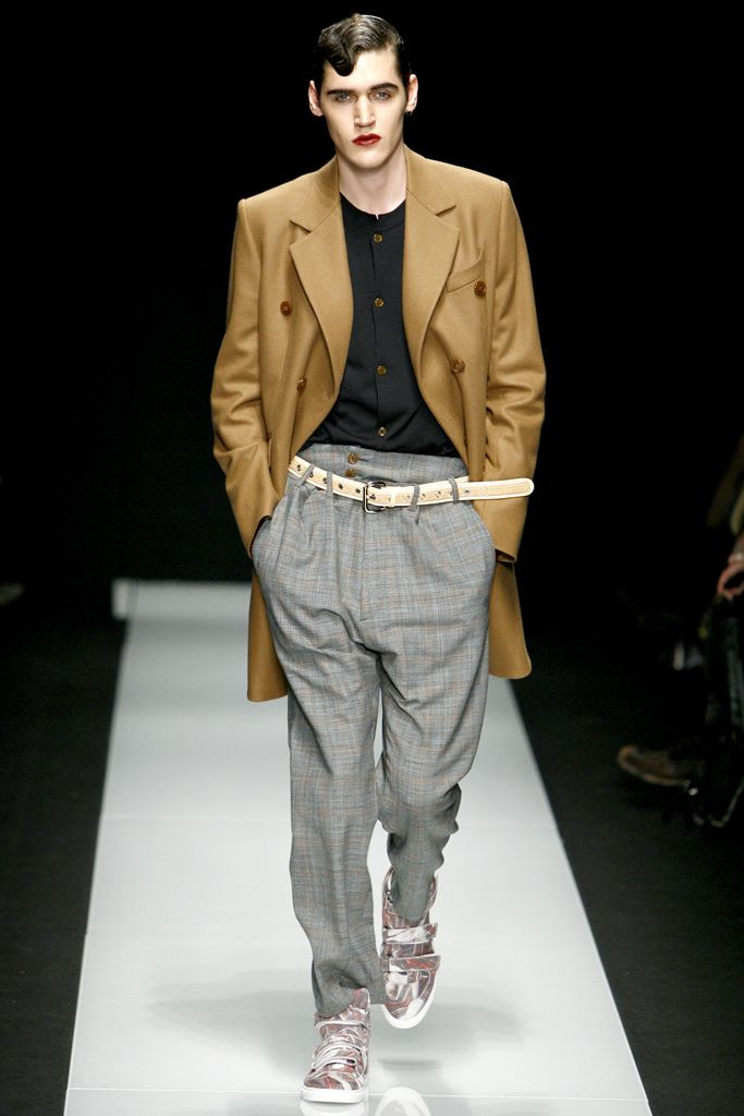 Here we see an ensemble similar to that of the Zoot Suit from the 1930s-1940s. The baggy, high waisted pants and long jacket represent the suit worn during this time. Though not exactly identical, you do see some similarities. 2/28/15