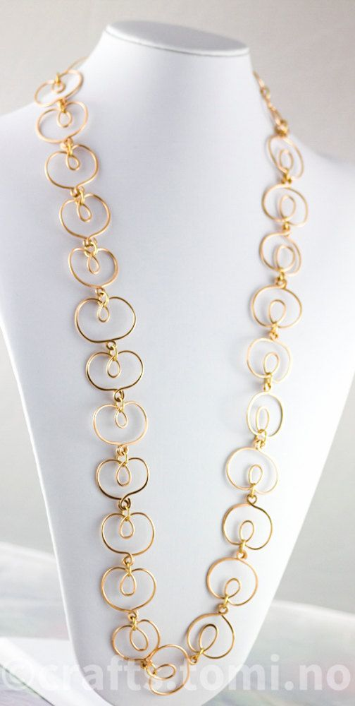 Long golden statement necklace in bronze hammered wrapped links