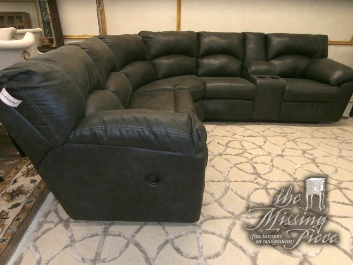 Five piece reclining sectional in pewter by Ashley Furniture.  One of the five pieces in a console to store the remotes and your beverages of choice. Just push right back and enjoy the game!