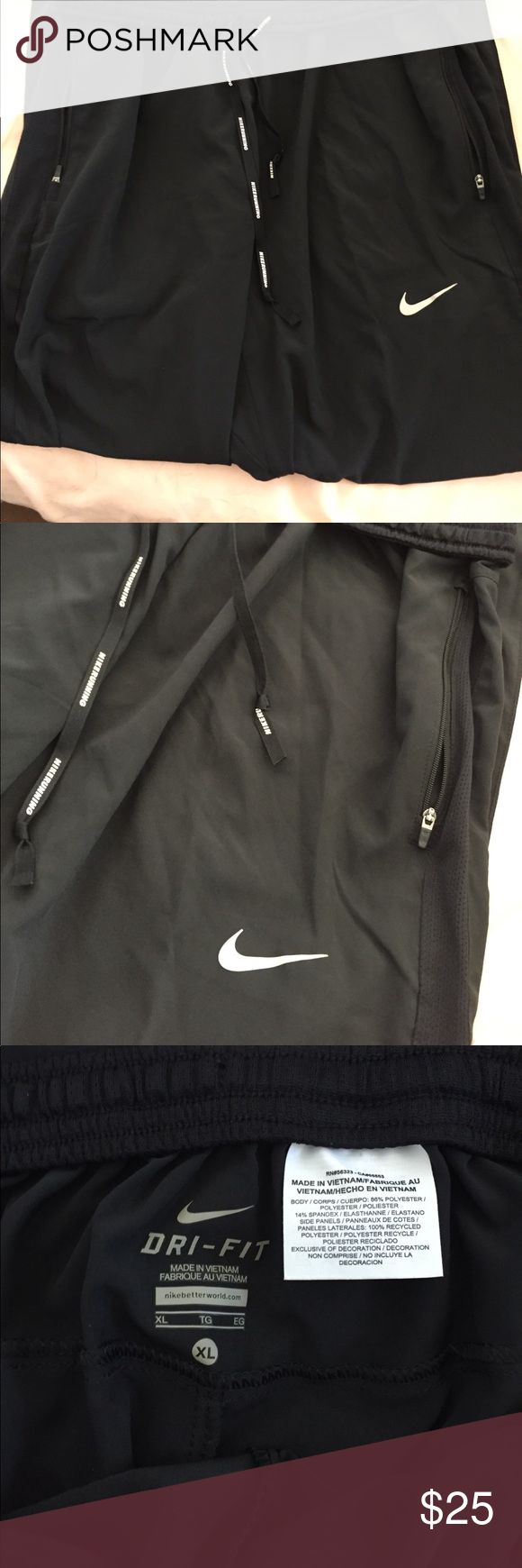 Nike running pants Lightweight material. Nike running pants with iconic Nike logo and drawstrings. Zippered pockets and partial zip up on the ankle Nike Pants Track Pants & Joggers