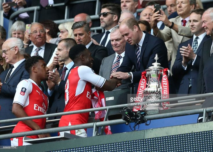 May 27th 2017, Wembley Stadium, London England; FA Cup Final, Arsenal versus Chelsea FC; HRH Prince William, Duke of Cambridge awards Danny Welbeck of Arsenal a FA Cup winners medal