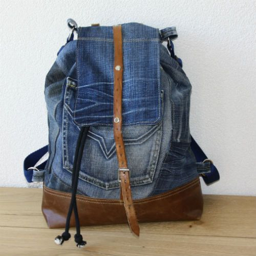 Old jeans and old leather from a couch. Together a new backpack!