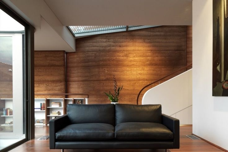 Elamang Avenue House by Luigi Rosselli - Rammed earth walls, operable skylight above  stairs. Beautiful sustainable design.
