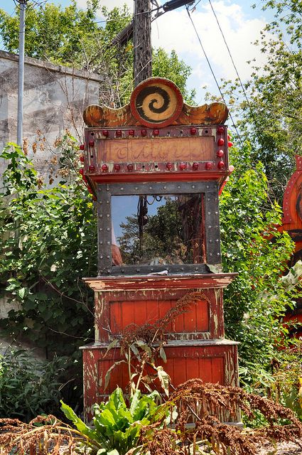 old fortune reading machine - a metaphor for the hopeful future that every baby is born with.  Neglected, disinterested, abused, devalued and discarded.  Now their future lies empty and rusting on the outskirts of a ghost town.  What future do these children have now?