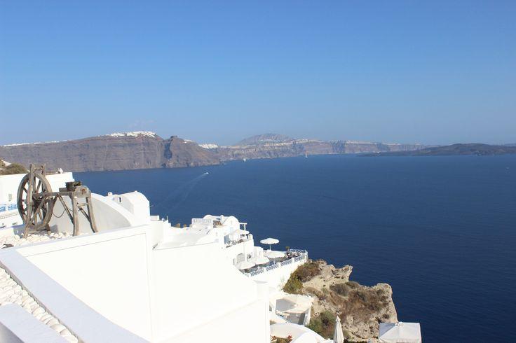 Breathtaking view with a spinning wheel. Oia, Santorini https://arturania.com/santorini