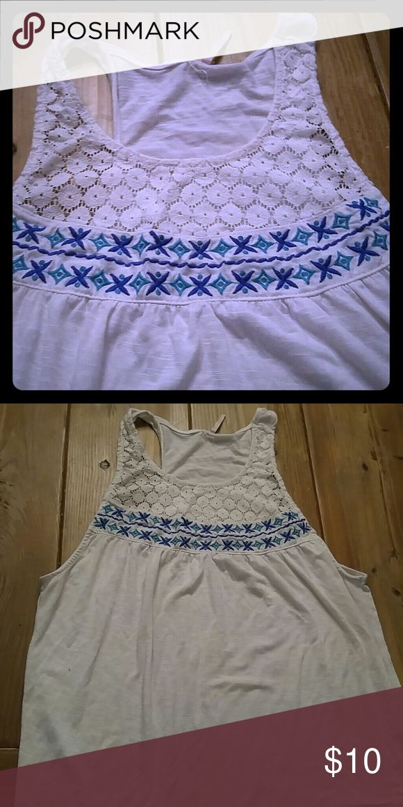 Blue and white tank Blue and white tank top with detail. Does go low down arm pits but cute with bandeau or bikini! :) Tops Tank Tops