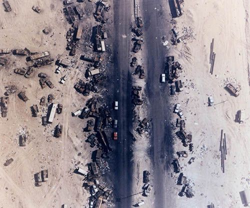 """Highway of Death, The result of American forces bombing retreating Iraqi forces, Kuwait, 1991 Allied forces bombed them from the air, killing hundreds of troops in their vehicles in what became known as the """"Highway of Death""""."""