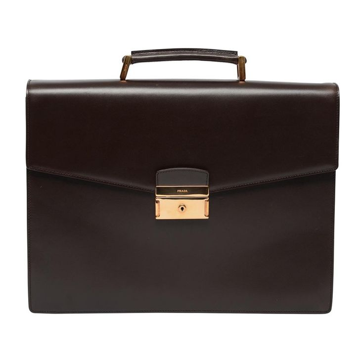 This Prada briefcase is made of chocolate box calf leather with gold tone hardware. This is a classic style, with a casual appeal making it the perfect work bag. It is in excellent condition, and ...