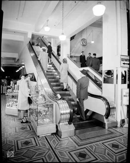 Woodward's department store escalators  VPL Accession Number: 26713  Date: date unknown  Photographer / Studio: Dominion Photo Co.  Topic: Department stores