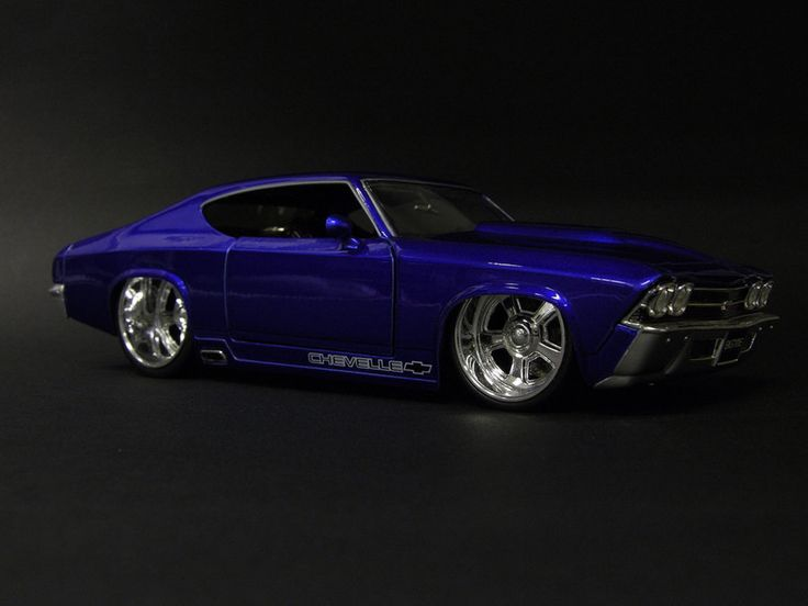 [69 Chevelle]  ... Ok, the dub wheels are throwing me off a bit for old-school, but hey - it gives it a contempo twist  (... and how does it make a turn when the wheel is packed in the wheel well ??)