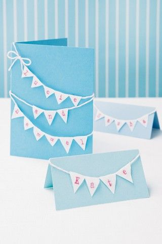 Reflect your country theme with linen bunting. Cut triangles from linen. Using rubber stamps and an ink pad, spell out the names of your guests. Glue the triangles to a piece of twine attach to place cards and blank invitations using glue. Make a twine bow and glue it to the twine in the top corner.