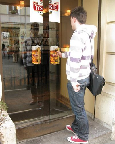 Tyskie Beer Door Handles | Beer mug stickers were installed behind doors of restaurants, pubs and shops as a part of creative Tyskie beer advertising campaign.