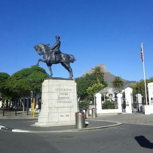 Statue of General Louis Botha, Statesman and Soldier, outside Houses of Parliament, Cape Town. Lion's Head in the background.