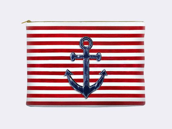Choose between two sizes for this sporty cosmetic bag with a nautical theme. The navy blue anchor is a woodent piece I painted then photographed