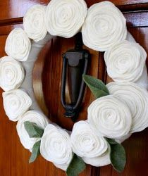 Felt Flower Wreath. You can use these lovely flowers to spruce up tons of projects. Use them to make a decorative pillow or a wreath (like the one shown) for a holiday craft. Follow the Felt Flower Tutorial - the possibilities are endless. #spring #easter Painting the roses red!
